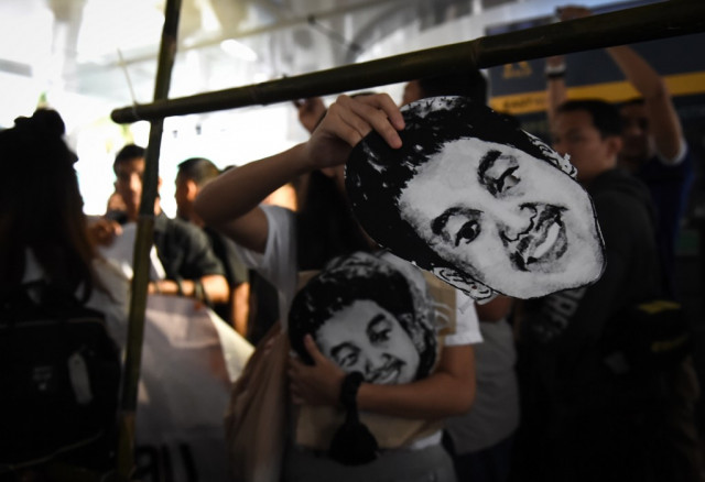 Thai activist jailed for insulting monarchy freed in royal pardon