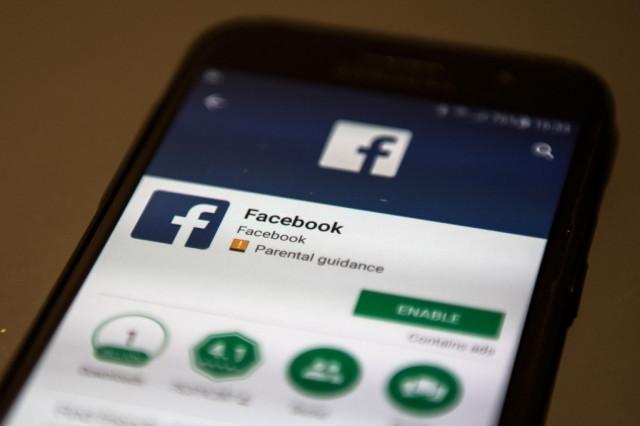 Vietnam jails two activists for 'spreading propaganda' on Facebook