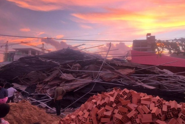 At least 3 dead, over dozen trapped as under-construction building collapses in SW Cambodia