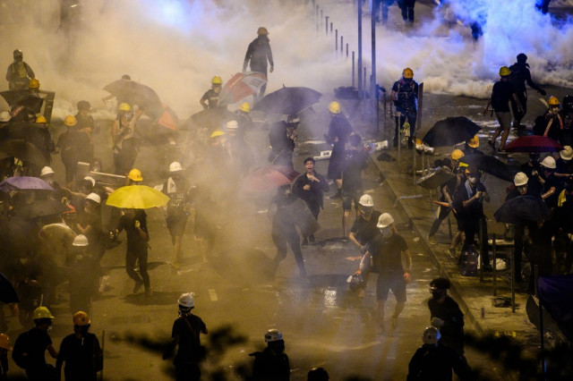 First charges against Hong Kong anti-government protester