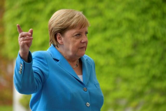 Merkel says 'very well' despite third shaking spell