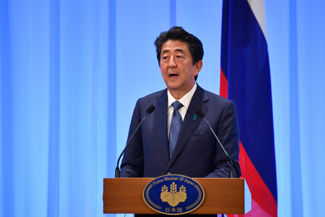 Japan's Abe on course to retain majority in upper house election