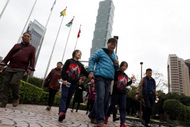 China halts individual travel to Taiwan