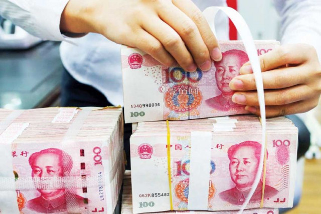 Chinese yuan falls to weakest level against dollar since 2010