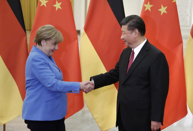 Merkel in Beijing says Hong Kong freedoms must be 'guaranteed'