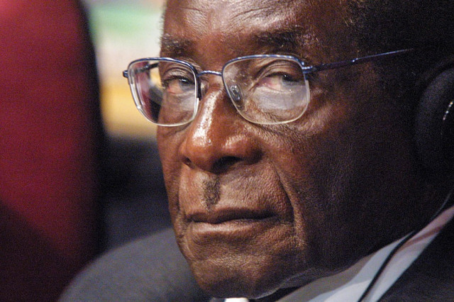 Why did Mugabe spend his last days in Singapore?