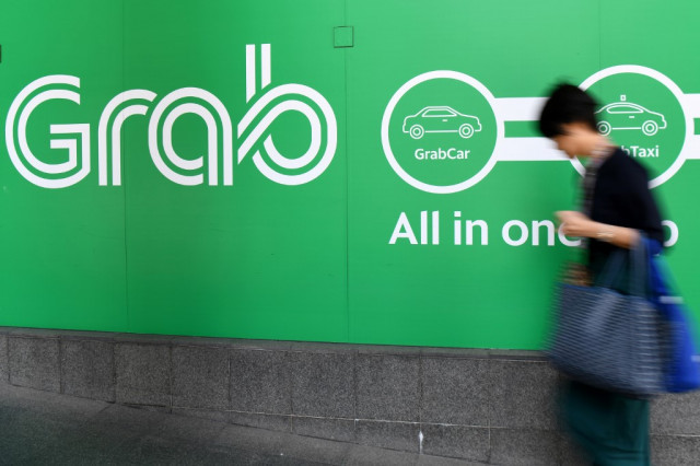 Malaysia threatens ride-hailing firm Grab with $21 million fine