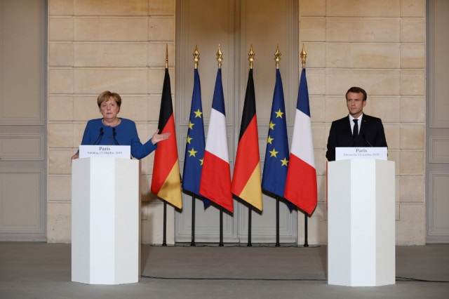 Macron, Merkel meet to harmonise positions before EU summit