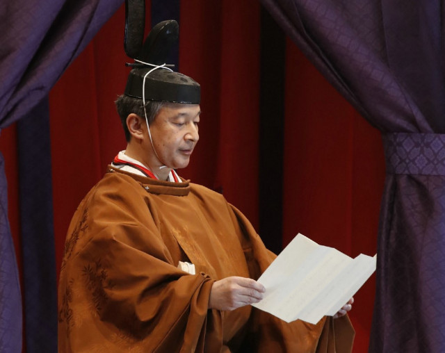 Japan's emperor completes enthronement in ancient ceremony