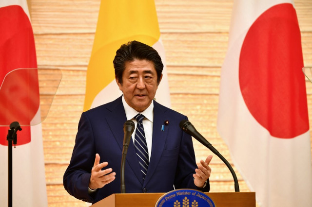 N. Korea blasts Japan's Abe, warns of 'real ballistic missile'
