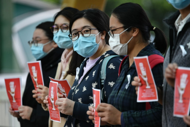 Hong Kong medics strike for China border closure over virus fears