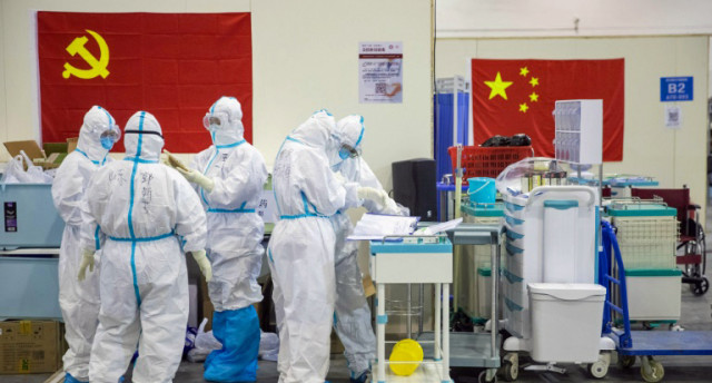 China virus cases drop as foreign fears rise