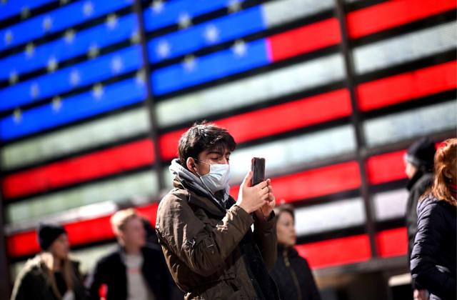 Americans urged to wear masks as virus toll mounts around world