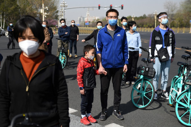 China pauses in memory of virus victims and 'martyrs'