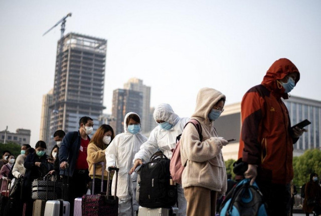 Wuhan exodus sparks virus hope despite mounting death toll
