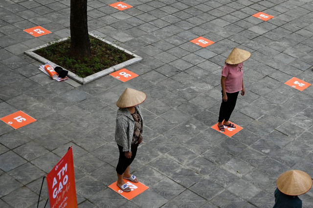 Vietnam relaxes virus restrictions as cases plateau