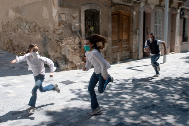 'We're going out!': Spanish kids reclaim streets after weeks indoors
