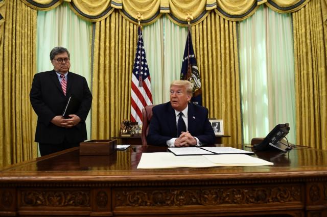 Trump signs order targeting social media after tweets flagged