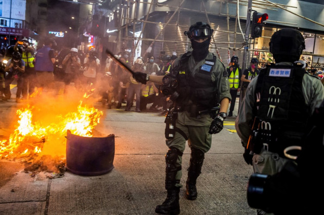 Chinese media use race clashes to criticise US over Hong Kong