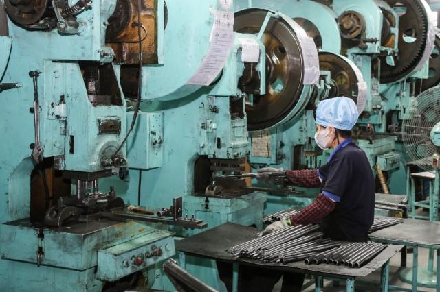 China's factory goods prices slump on virus shock