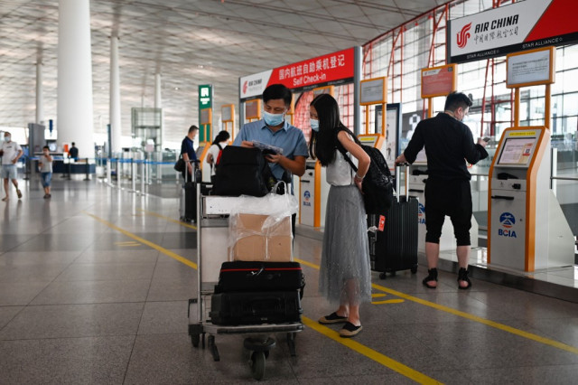 China cancels flights, classes over new outbreak as India deaths soar