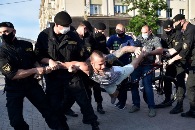 Belarus detains dozens at opposition protests ahead of election