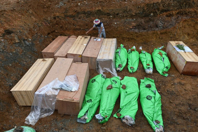 Dreams of Myanmar's 'unwashed' jade miners buried by disaster