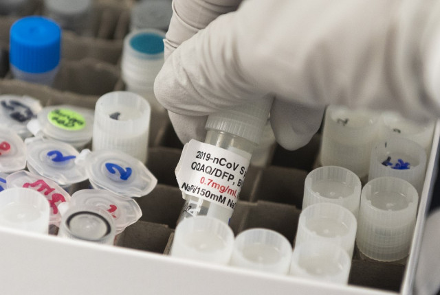 US to buy 100 million doses of potential virus vaccine