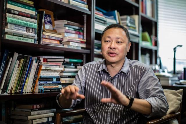 Anger grows over Hong Kong university sacking of activist