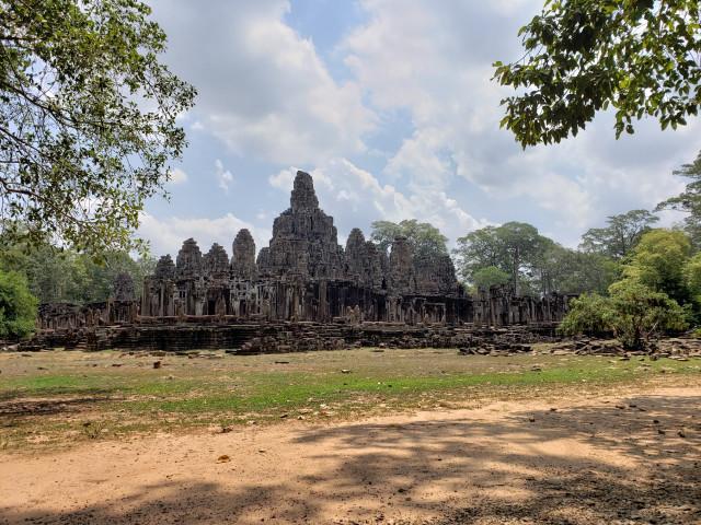 The Stone Smiles of Bayon Temple Go Unreciprocated