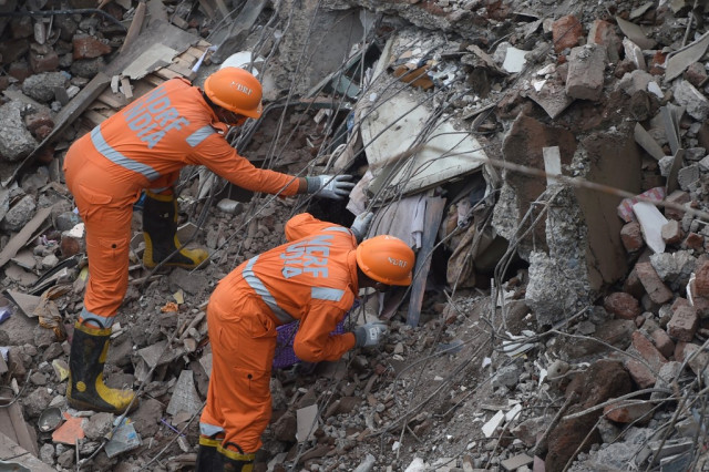 Search for survivors after India building collapse