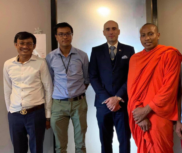A Youth Leader and a Buddhist Monk Are Arrested and Charged over Plans to Hold a Demonstration