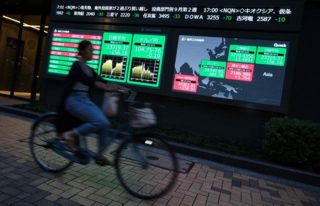 Asian markets slip as vaccine halt dents optimism