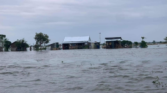 Father Dies Trying to Save Son as Flood Deaths Rise to 34