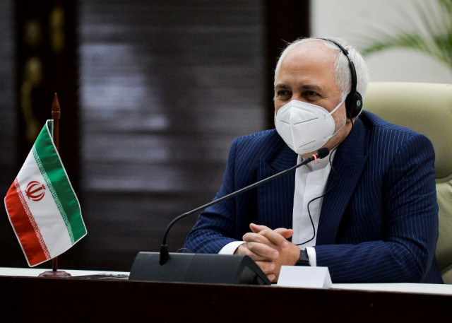 Iran says to meet nuclear commitments if Biden lifts sanctions