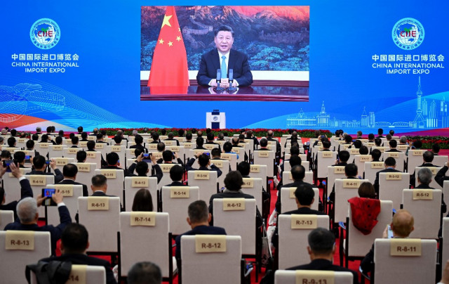 Xi touts China's huge economy as base of free trade in APEC speech