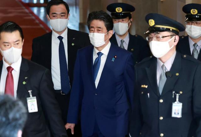 Japan ex-PM Abe faces lawmakers on scandal but avoids prosecution