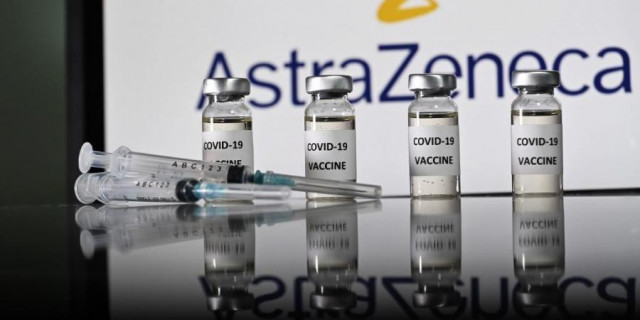 UK approves lower-cost vaccine as pandemic surges