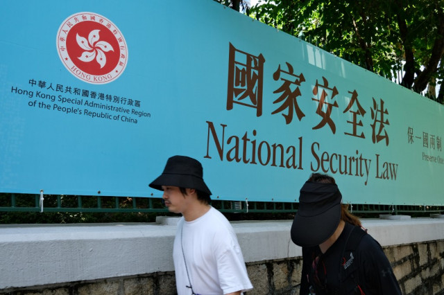 Dozens of Hong Kong opposition figures arrested under security law