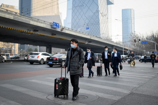 China to issue visas to foreigners who have taken Chinese jab