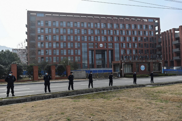China says US peddling conspiracies as lab-leak theory returns