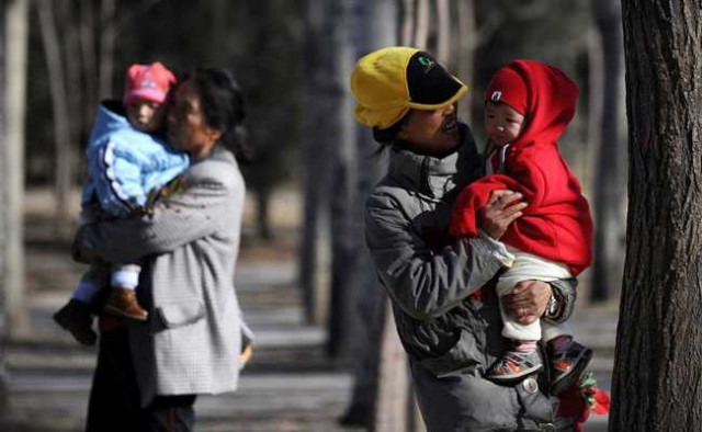 China allows couples to have three children: state media