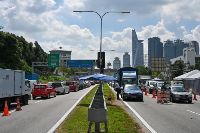 Malaysia imposes lockdown as Southeast Asia battles virus surge