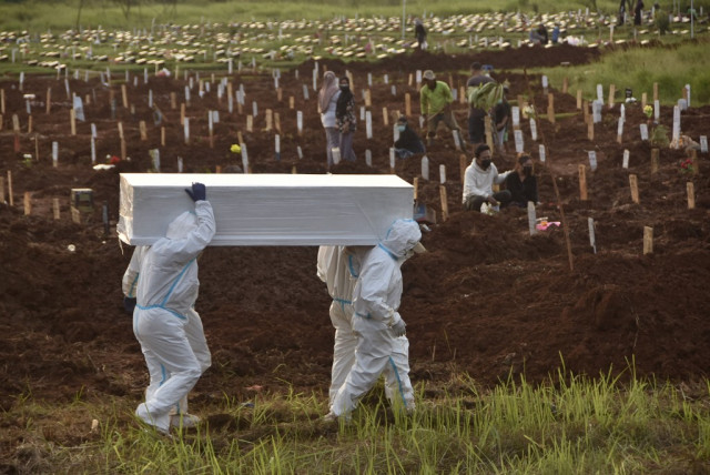 Indonesia rolls out tougher curbs as virus cases skyrocket