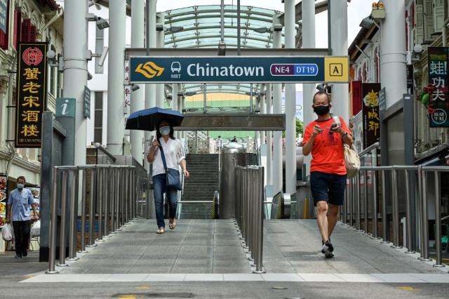 Singapore police probe karaoke bars after virus outbreak