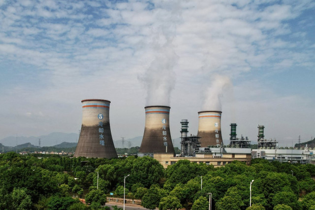 China steps up climate fight with emissions trading scheme