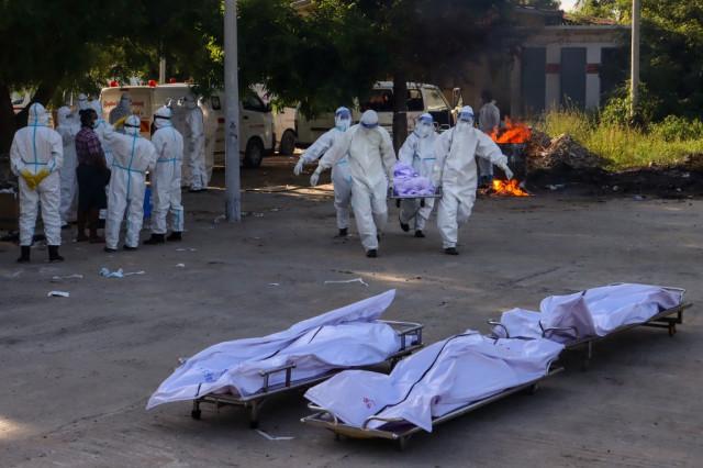 'Dead body carrier': Covid surge overwhelms Myanmar burial volunteers