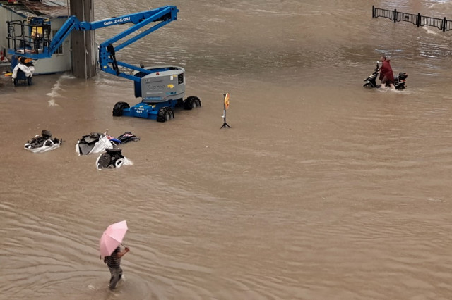 12 dead in flooded subway as downpours hit central China