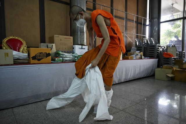 Thai monks don protective gear as Covid cases surge