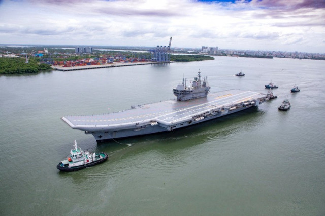 India flexes muscles with new aircraft carrier, task force